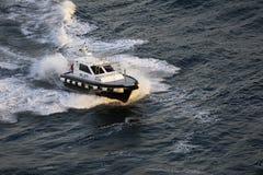 Pilot Boat Creating Waves Fotografering för Bildbyråer