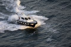 Pilot Boat Creating Waves Stock Image
