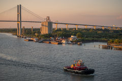 Pilot boat cruises at dusk on Savannah River in Savannah, GA Royalty Free Stock Photography
