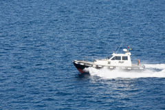 Pilot Boat Cutting Across Blue Water Royalty Free Stock Photography
