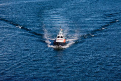 Pilot Boat Cutting Through Blue Water Stock Photos