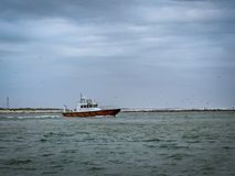 Pilot boat going out to sea. stock photo