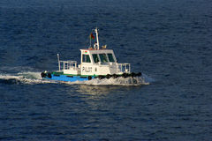 Pilot boat. In harbor coming to a ship Stock Photo