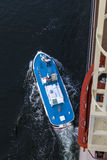 Pilot boat heads away from cruise ship Stock Photo
