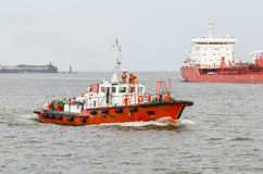 A pilot boat and a large  ship Royalty Free Stock Photos