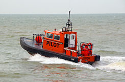 Pilot boat leaving harbour Royalty Free Stock Photography