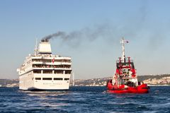 Pilot boat monitors luxury ship Stock Photography