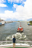 Pilot boat moves cruiser. Pilot boat at operation Royalty Free Stock Images