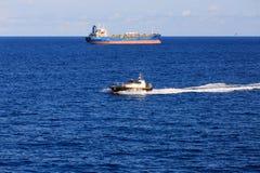 Pilot Boat Past Tanker Arkivfoton