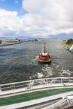Pilot boat pushs cruiser. Pilot boat at Operation on the Baltic Sea Stock Photo