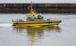 Pilot Boat by Seawall Stock Photo