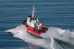 Pilot Boat In Victoria. Pilot boat speeding away from cruise ship in Vancouver Stock Image
