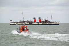 Pilot boat and waverley paddle steamer Stock Photography