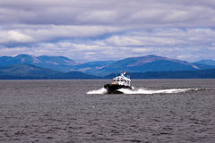 Pilot boat on waves at mouth of Columbia River Stock Images