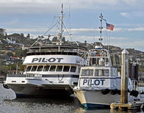 Pilot Boats. Awaiting the next task of guiding commercial shipping into the harbor channel stock image