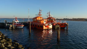 Pilot boats in harbor on a sunny winter day Royalty Free Stock Photos