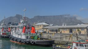 Pilot Boats at table mountain stock photography