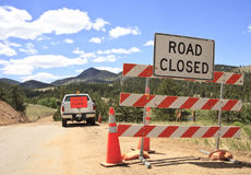 Pilot car and road closed sign Stock Photos