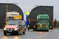 Pilot Car and Two Trucks with Oversize Loads Stock Images