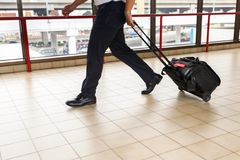 Pilot carries his luggage at the airport Royalty Free Stock Photo