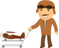 Pilot with cart gift toy plane Royalty Free Stock Images