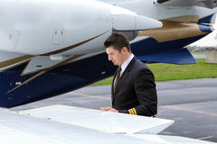 Pilot checking flaps Royalty Free Stock Photo