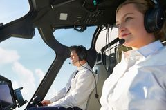 Pilot And Co Pilot In Cockpit Of Helicopter stock photos