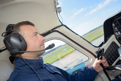 Pilot in cockpit aircraft. Pilot in cockpit of aircraft Stock Photo