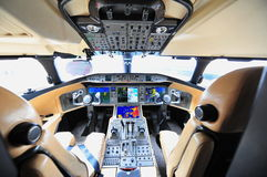 Pilot cockpit of a Bombardier Global 6000 business jet at Singapore Airshow. SINGAPORE - FEBRUARY 12: Pilot cockpit of a Bombardier Global 6000 business jet at Stock Photos
