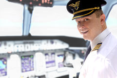 Pilot in cockpit. Young pilot in airplane cockpit stock photo