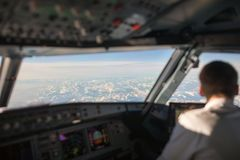 Pilot in a commercial airliner airplane flight cockpit Stock Image