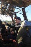 Pilot controlling hot air balloon Stock Images