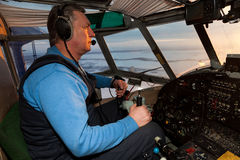 Pilot is controlling the old plane Royalty Free Stock Images