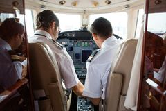 Pilot And Copilot In Cockpit Of Corporate Jet Royalty Free Stock Photography