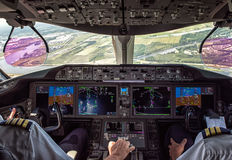 Pilot and copilot in commercial plane Stock Image