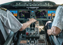 Pilot and copilot in commercial plane Royalty Free Stock Photos