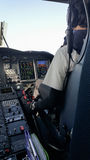 Pilot and copilot in corporate plane in cockpit, Pilot operation with control panel Royalty Free Stock Photos