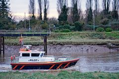 Pilot Cutter. Heading out to sea to pick up the pilot who has taken a cargo ship out of the river nene near high tide Royalty Free Stock Images
