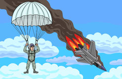 The pilot descends by parachute. The plane crashed, but the pilot managed to escape Stock Images