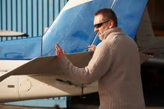 Pilot doing pre-flight checking stock images