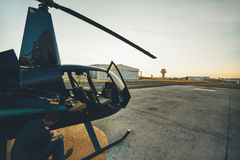 Pilot doing pre flight inspection at helicopter royalty free stock image