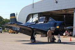 Pilot executes Preflight inspection of North American T-28 Trojan ? Hamilton SkyFest 2014 Stock Photography