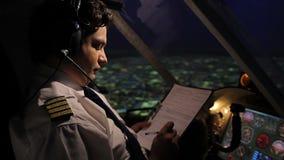 Pilot filling out flight documentation, plane flying in autopilot mode, aviation stock footage