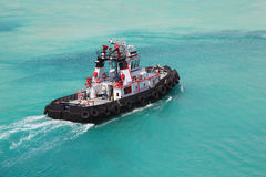 Pilot on fire pusher tug drift through sea Royalty Free Stock Images