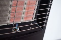 Pilot-flame on a portable gas heater. Clos up on the pilot-flame on a portable gas heater royalty free stock image