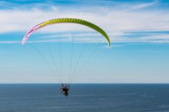 Pilot Flies with a Motorized Paraglider Near Torrey Pines Gliderport Royalty Free Stock Images