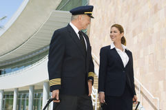 Pilot And Flight Attendant Outside Building Stock Photos