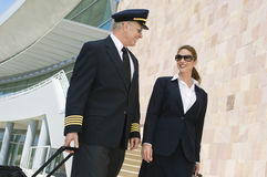 Pilot And Flight Attendant Outside Building royalty free stock photo