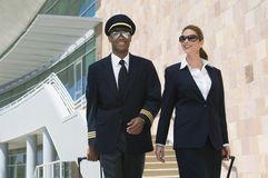 Pilot And Flight Attendant Outside Building Royalty Free Stock Image
