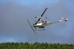 Pilot In-Flight In A Crop Dusting Agriculture Helicopter. Stock Photography